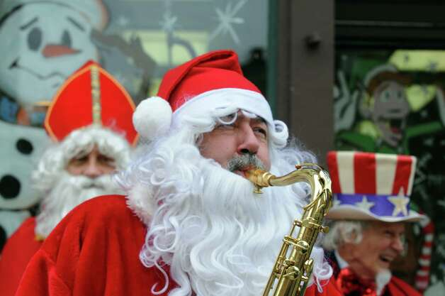 """Luke Sax-O-Clausa€ McNamee plays Christmas songs as  """"Henry Livingston Jr. Day"""" was proclaimed to be Dec. 23, 2014 in Troy, in honor of the surprise jury verdict after the Dec. 7 """"Trial Before Christmas,"""" held in the Rensselaer County Courthouse in front of Some Girls Boutique on Friday Dec. 19, 2014 in Troy ,N.Y.  (Michael P. Farrell/Times Union) Photo: Michael P. Farrell / 00029936A"""
