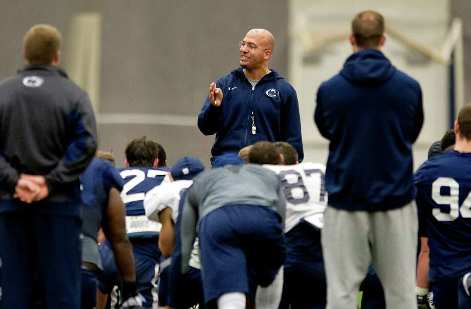 Penn State football coach James Franklin talks to his player after practice on Saturday, Dec. 13, 2014, at Holuba Hall in University Park, Pa. The team is preparing for the Pinstripe Bowl where they will play Boston College. (Abby Drey/Centre Daily Times/TNS) Photo: Abby Drey, MBR / McClatchy-Tribune News Service / Centre Daily Times