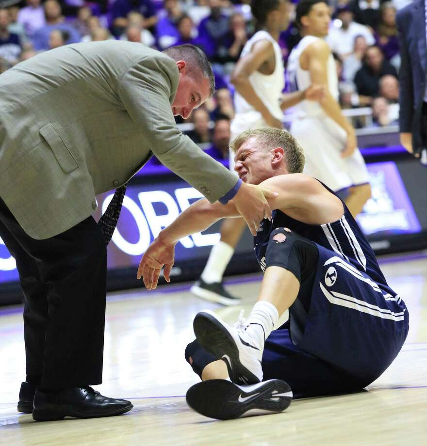 BYU guard Tyler Haws grimaces in pain after twisting his ankle late during an NCAA college basketball game, Saturday, Dec. 13, 2014 in Ogden, Utah. (AP Photo/Standard-Examiner, Dennis Montgomery ) TV OUT; MANDATORY CREDIT Photo: Dennis Montgomery / Associated Press / Standard-Examiner