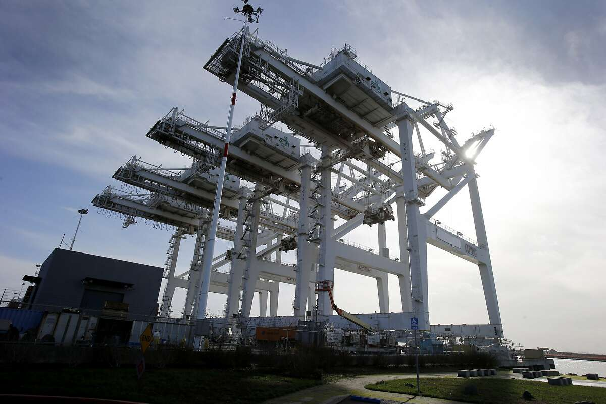 The massive cranes at the SSA Terminals Wednesday December 17, 2014. Truck drivers at the Port of Oakland often face long waits to get inside the terminals and pick up containers in a timely manner.