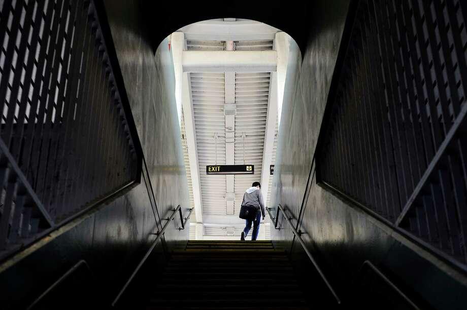 A passenger walks up to the platform