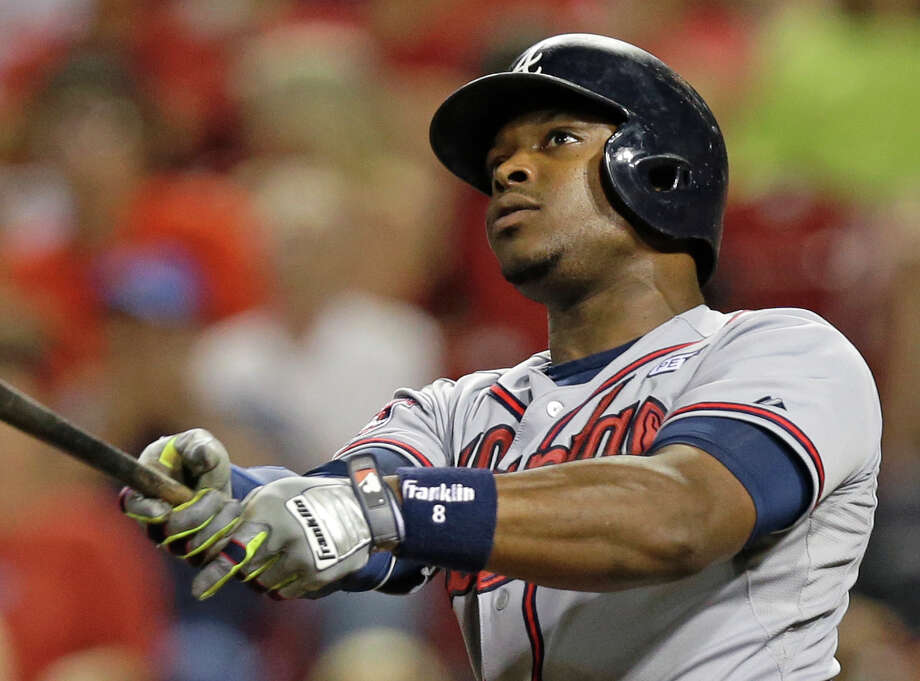 FILE - In this Aug. 22, 2014, file photo, Atlanta Braves' Justin Upton hits a two-run home run off Cincinnati Reds relief pitcher Manny Parra in the 12th inning of a baseball game in Cincinnati. A person with knowledge of the deal says the San Diego Padres have agreed to acquire slugger Justin Upton from the Atlanta Braves. The person, speaking on condition of anonymity Friday, Dec. 19, 2014,  because the teams had not announced the deal, said the Braves will receive a group of prospects.  (AP Photo/Al Behrman, File) Photo: Al Behrman / Associated Press / AP