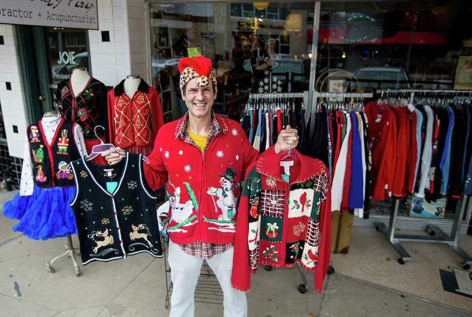 Portrait of Mike Hildebrand, co-owner of the vintage store Replay on 19th Street, shows off his ugly Christmas sweaters outside his shop Wednesday, Dec. 17, 2014, in Houston.  Hildebrand said his shop has made ugly Christmas sweaters a big part of his business the past few years since the craze had taken off about six years ago. This year he has purchased more than 400-pounds of the tacky wool trappings.  ( Johnny Hanson / Houston Chronicle ) Photo: Johnny Hanson, Staff / © 2014  Houston Chronicle