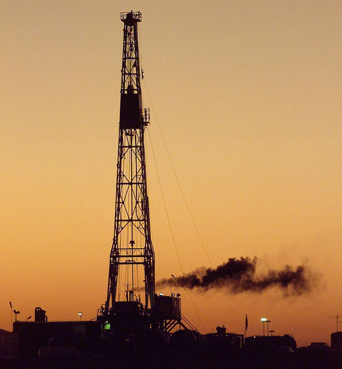 One of Texas' oil downturns was in the late 1990s, about the time this drilling rig was working near MIdland in the Permian Basin. (AP Photo/Midland Reporter Telegram/Curt Wilcott,File).