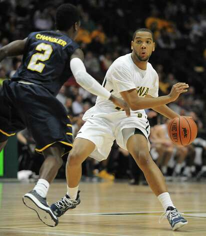 Siena's Patrick Cole, right, is guarded by Quinnipiac's Kasim Chandler during a basketball game at the Times Union Center on Friday, Dec. 5, 2014 in Albany, N.Y. (Lori Van Buren / Times Union) Photo: Lori Van Buren / 00029714A