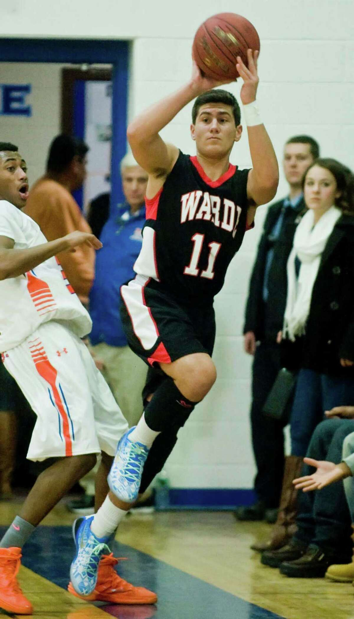 Fairfield Warde High School's Giacomo Brancato looks to pass in a game against Danbury High School, played at Danbury. Friday, Dec. 19, 2014