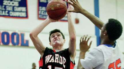 Fairfield Warde High School's JJ Conway goes up for a shot during a game against Danbury High School, played at Danbury. Friday, Dec. 19, 2014