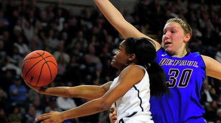 UConn's Moriah Jefferson goes to the basket as DePaul's Megan Podkowa defends, during women's baskeball action at the Webster Bank Arena in Bridgeport on Friday Dec. 19, 2014.