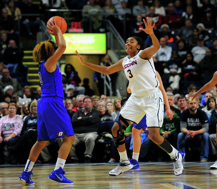 UConn's Morgan Tuck looks to block a pass attempt by DePaul's Chanise Jenkins, during women's baskeball action at the Webster Bank Arena in Bridgeport on Friday Dec. 19, 2014. Photo: Christian Abraham / Connecticut Post