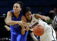 DePaulís Jessica January, left, and Connecticutís Moriah Jefferson collide during the second half of an NCAA college basketball game, Friday, Dec. 19, 2014, in Bridgeport, Conn. Connecticut won 98-64.