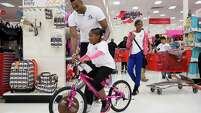 Diamond Milam, 8, was one of 154 children treated to a Christmas shopping trip to Target by Rockets center Dwight Howard and his foundation.