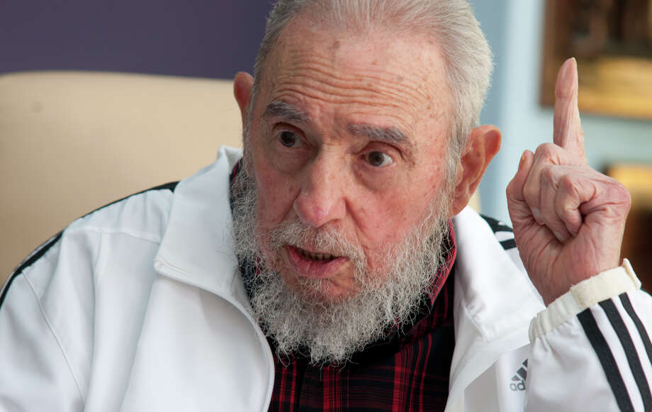FILE - In this July 11, 2014 file photo, Cuba's Fidel Castro speaks with Russia's President Vladimir Putin in Havana, Cuba. Amid the excitement over the thaw in U.S.-Cuba relations, one person has been conspicuously absent: Fidel Castro. The former Cuban president hasn't made any public comment about the announcement that the U.S. and Cuba will restore diplomatic relations after more than 50 years of hostility.(AP Photo/Alex Castro, File) ORG XMIT: XLAT112 Photo: Alex Castro / AP