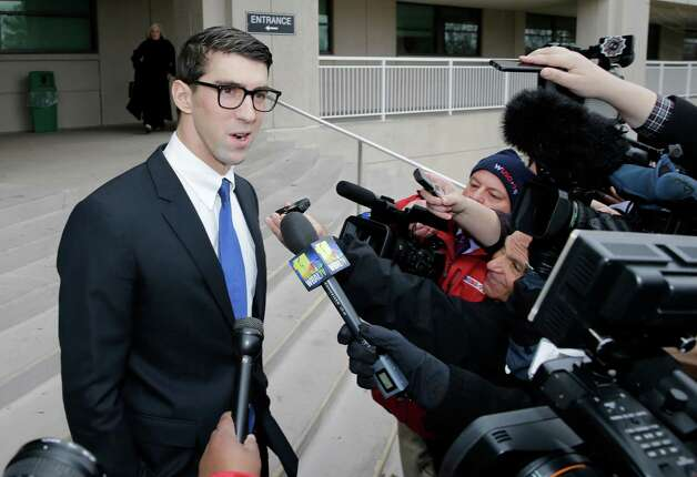 Olympic swimmer Michael Phelps speaks with reporters after he walked out of a courthouse where he pleaded guilty to drunken driving, Friday, Dec. 19, 2014, in Baltimore. He was sentenced to a year in prison for the Sept. 30 arrest, but the prison sentence is suspended. He must be on probation for a year and a half.(AP Photo/Patrick Semansky) ORG XMIT: MDPS106 Photo: Patrick Semansky / AP