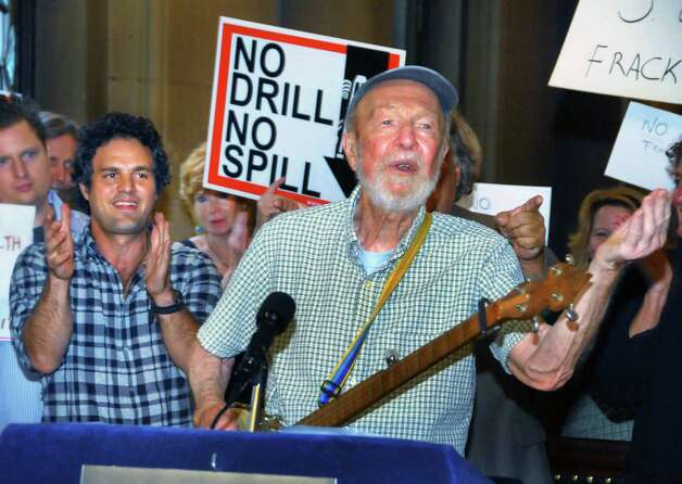 """Screen actor Mark Ruffalo, left, cheers as folk singer and activist Pete Seeger performs a song during a news conference calling on the state legislature to pass a moritorium on """"fracking"""" Tuesday July 20, 2010, at the State Capitol in Albany.  (John Carl D'Annibale / Times Union) Photo: John Carl D'Annibale / 00009560A"""