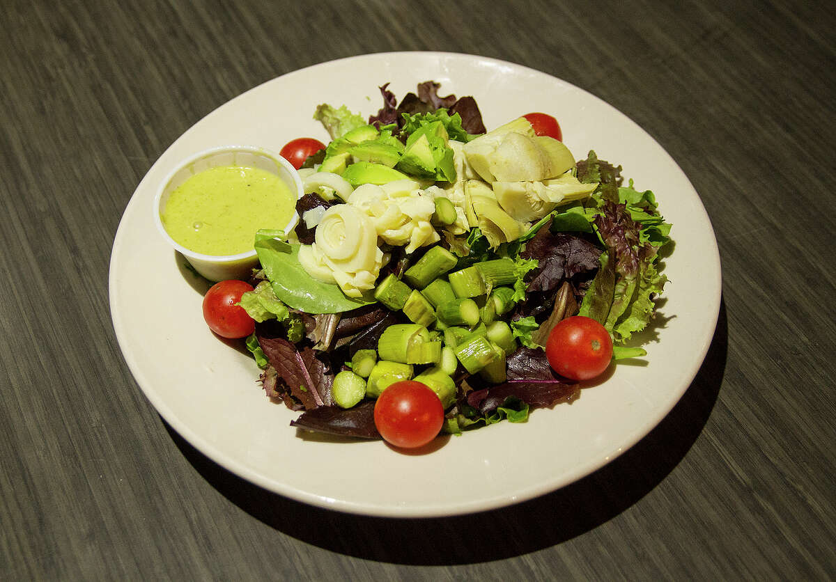 The Freetail salad includes spring mix, asparagus, artichoke hearts, hearts of palm, avocado, tomato and cilantro lime dressing.