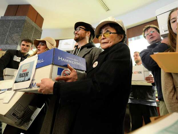 Sean Lennon and Yoko Ono, representing Artists Against Fracking, joined other activist groups as they went to the Environmental Conservation building Jan. 11, 2013, in Albany, N.Y. (Skip Dickstein/Times Union) Photo: SKIP DICKSTEIN / 00020738A