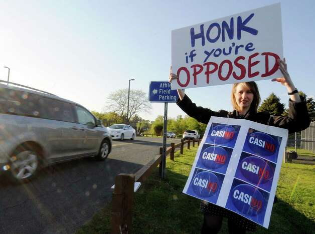 Silvy Lang from the No East Greenbush Casino Face Book Group holds a protest sign infront of the Columbia High School prior to a presentation by the Saratoga Casino and Raceway on proposed Casino in East Greenbush, N.Y., Monday, May 19, 2014. (Hans Pennink / Special to the Times Union) ORG XMIT: HP101 Photo: Hans Pennink / Hans Pennink