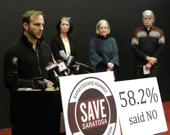 Benj Gleeksman of Saratoga Springs, left, speaks out against expansion of Vegas-style casinos in the city during an assembly Dec. 16, 2013 in Saratoga Springs, N.Y.     (Skip Dickstein / Times Union) Photo: Skip Dickstein / 00025048A