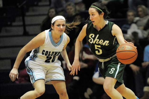 Shen's Erin Hulbert, right, controls the ball as Columbia's Kylee Arno defends during their basketball game on Friday Dec. 19, 2014, at Columbia High in East Greenbush, N.Y. (Cindy Schultz / Times Union) Photo: Cindy Schultz / 00029933A