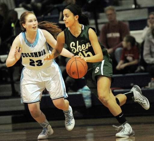Shen's Sydney Quinn, right, controls the ball as Columbia's Grace Heeps defends during their basketball game on Friday Dec. 19, 2014, at Columbia High in East Greenbush, N.Y. (Cindy Schultz / Times Union) Photo: Cindy Schultz / 00029933A