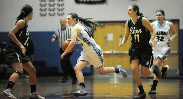 Columbia's Sarah Jaromin, center, drives up court during their basketball game against Shenendehowa on Friday Dec. 19, 2014, at Columbia High in East Greenbush, N.Y. (Cindy Schultz / Times Union) Photo: Cindy Schultz / 00029933A