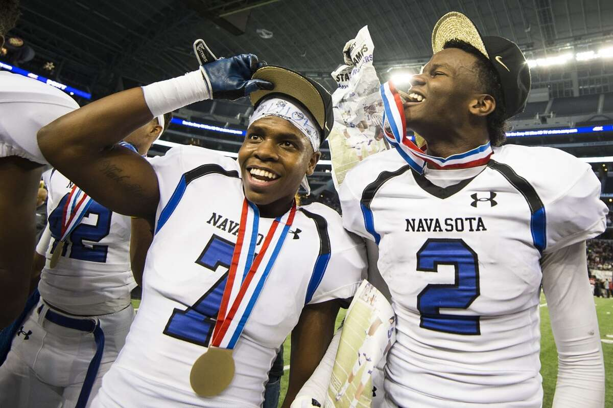 Navasota wide receiver Tren'Davian Dickson (2) and defensive end Christian Taylor (7) celebrate after the Rattlers defeated Argyle in the Class 4A Division I state football title game at AT&T Stadium Friday, Dec. 19, 2014, in Arlington. ( Smiley N. Pool / Houston Chronicle )