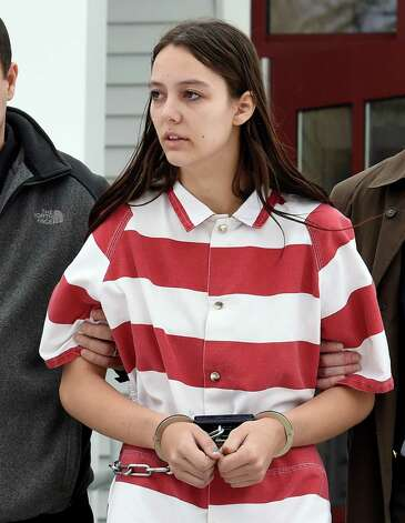 Tiffany VanAlstyne, 19, is escorted out of Knox Town Court Friday afternoon, Dec. 19, 2014, in Knox, N.Y., where she was arraigned on 2nd degree murder charges for the alleged strangulation death of her cousin, 5-year-old Kenneth White. Photo: SKIP DICKSTEIN, Skip Dickstein/Times Union