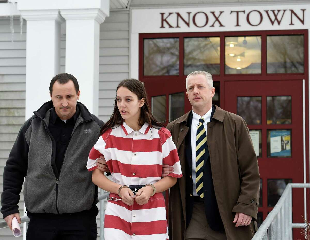 Tiffany VanAlstyne, 19, is escorted out of Knox Town Court Friday afternoon, Dec. 19, 2014, in Knox, N.Y., where she was arraigned on 2nd degree murder charges for the alleged strangulation death of her cousin, 5-year-old Kenneth White.