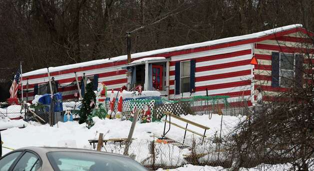 New York State Police Forensics Investigators search for evidence Friday afternoon Dec. 19, 2014, at 994 Thacher Park Road, the scene of the alleged murder of 5 year old Kenneth White.  The next day, a Knox building inspector officially shuttered the trailer, saying a wood stove was a fire hazard.  (Skip Dickstein/Times Union) Photo: SKIP DICKSTEIN