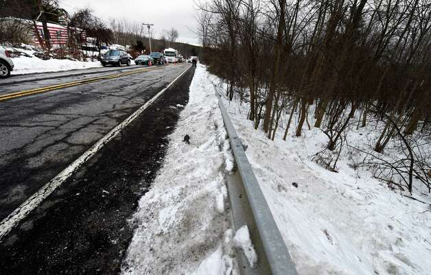 Blood stains lay in the snow Friday afternoon, Dec. 19, 2014, at the location where the body of 5-year-old Kenneth White was alleged to have been disposed Friday afternoon, Dec. 19, 2014, in Knox, N.Y. The area is across the road from 994 Thacher Park Road, the scene of the alleged murder. (Skip Dickstein/Times Union) Photo: SKIP DICKSTEIN