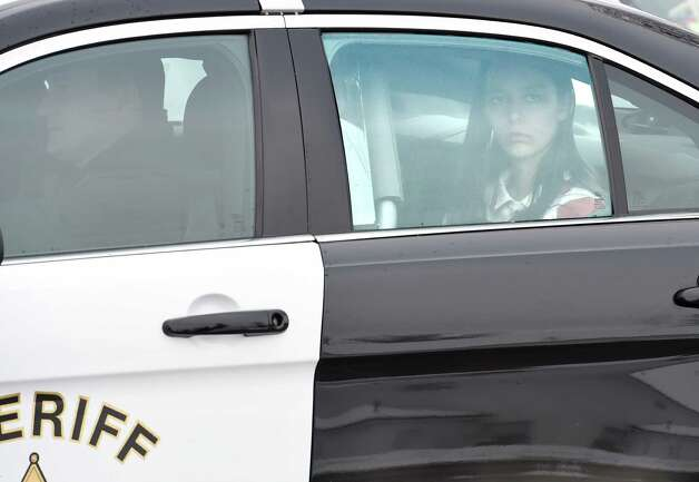 Tiffany VanAlstyne, 19, arrives at the Knox Town Court Friday afternoon, Dec. 19, 2014, in Knox, N.Y., for her arraignment on 2nd degree murder charges for the alleged strangulation death of her cousin 5 year old Kenneth White. The teenager pleaded not guilty. She was sent to the Albany County jail without bail. (Skip Dickstein/Times Union) Photo: SKIP DICKSTEIN
