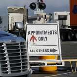 A sign on the busy Middle Harbor Road trying to direct truckers to terminals Wednesday December 17, 2014. Truck drivers at the Port of Oakland often face long waits to get inside the terminals and pick up containers in a timely manner.