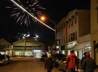 First Night fireworks as seen from Main Street on Jan. 1, 2014. The Board of Selectman, citing public safety concerned, denied a request to shoot the fireworks from the Post Road bridge.