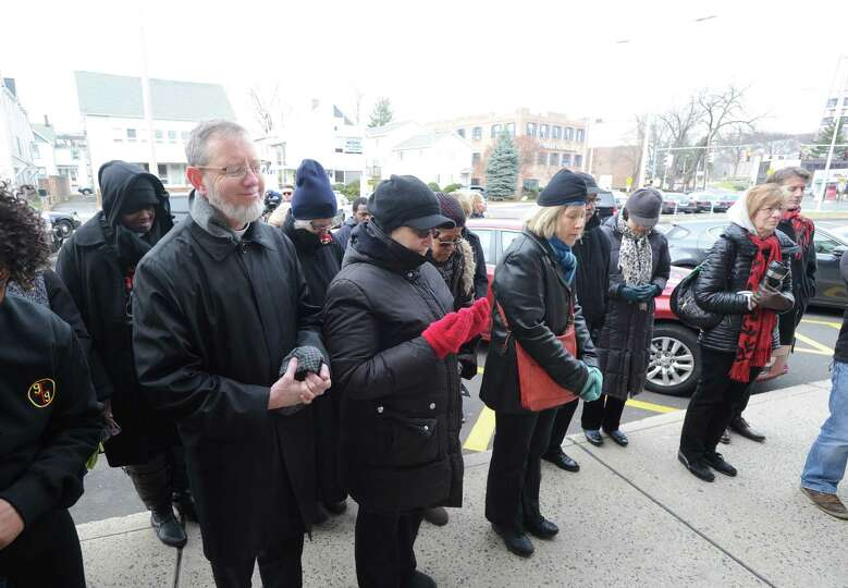 People pray during the Stamford NAACP Rally for Justice at the Stamford Police Department in Stamfor