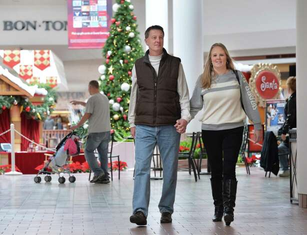 Joe and Cindy Kehn of Wilton shop for Christmas gifts at Wilton Mall Friday Dec. 19, 2014, in Wilton, NY.  (John Carl D'Annibale / Times Union) Photo: John Carl D'Annibale / 00029901A