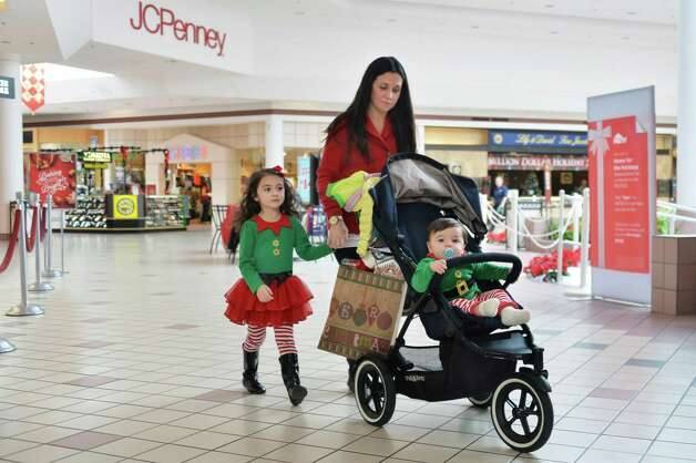 Juliet Baaklini of Saratoga Springs shops for Christmas gifts with her daughter Giavanna, 4, left, and son Tskander, 9 months, at Wilton Mall Friday, Dec. 19, 2014, in Wilton, N.Y.  (John Carl D'Annibale / Times Union) Photo: John Carl D'Annibale / 00029901A