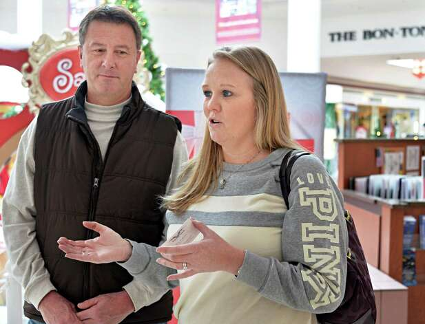 Joe and Cindy Kehn of Wilton discuss their Christmas shopping strategies with an interviewer at Wilton Mall Friday Dec. 19, 2014, in Wilton, NY.  (John Carl D'Annibale / Times Union) Photo: John Carl D'Annibale / 00029901A