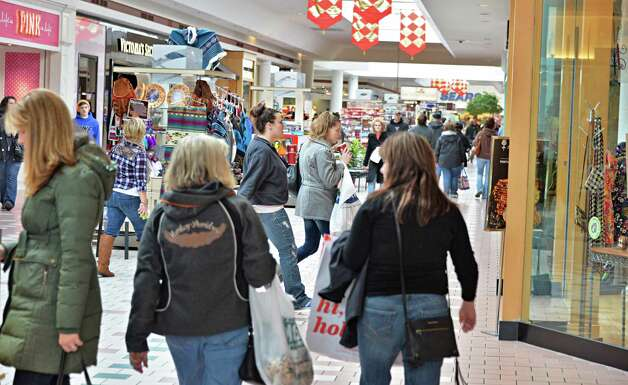 Shoppers hunt for Christmas gifts at Wilton Mall Friday Dec. 19, 2014, in Wilton, NY.  (John Carl D'Annibale / Times Union) Photo: John Carl D'Annibale / 00029901A