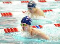Dolphins swimmer Brooke Collins, 16, of Greenwich, during the final of the 100 yard breaststroke event that she won during the annual Greenwich Town Swimming Championships at Greenwich High School, Greenwich, Conn., Saturday, Dec. 20, 2014.
