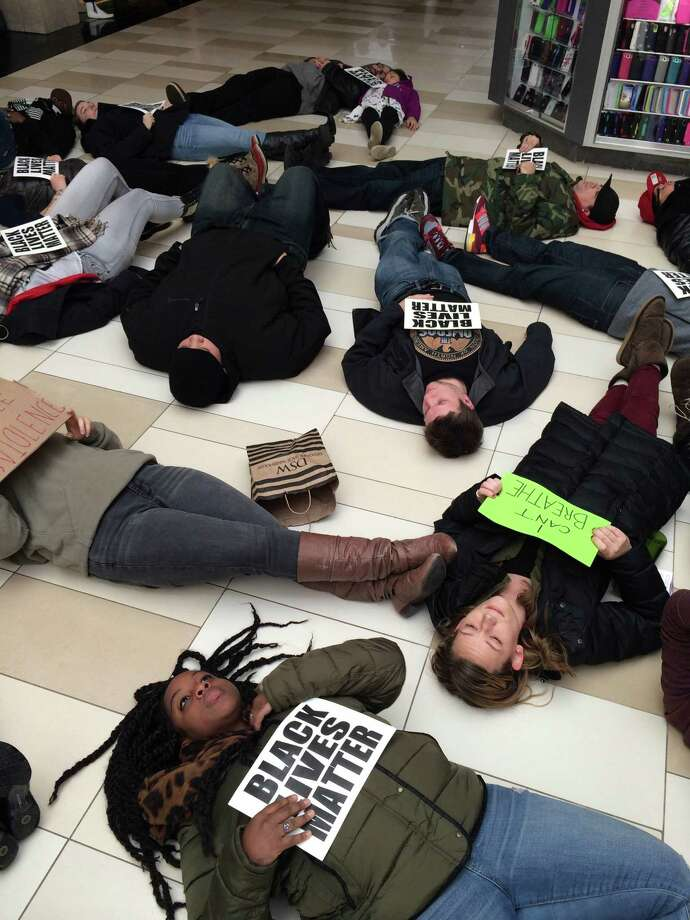 "Protesters participate in a ""die-in"" to remember the death of Eric Garner at the Crossgates Mall in Albany on Dec. 20, 2014. (Brittany Horn/Times Union)"
