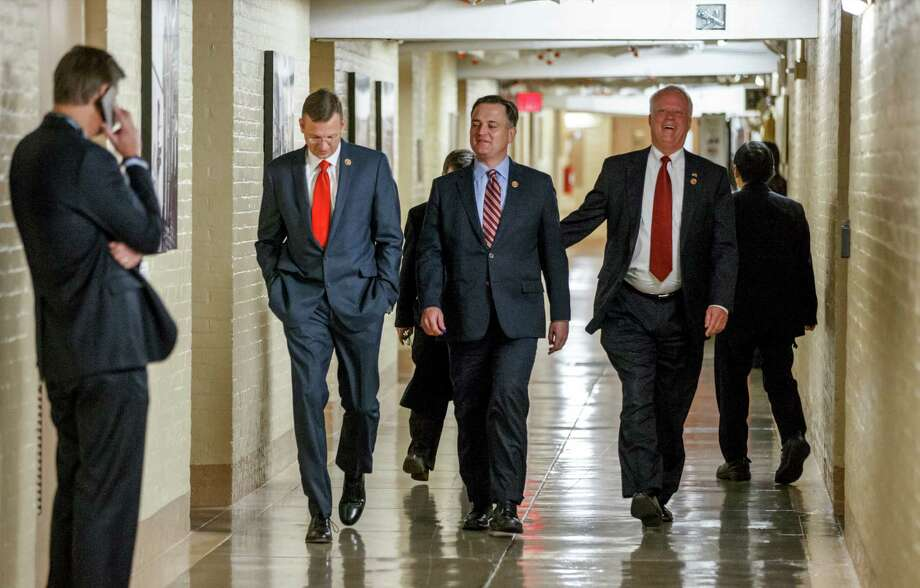 Reps. Doug Collins, R-Ga. (left), Luke Messer, R-Ind., and Paul Broun, R-Ga., walk through a Capitol hallway Wednesday as the 113th Congress winds down. Photo: J. Scott Applewhite / Associated Press / AP