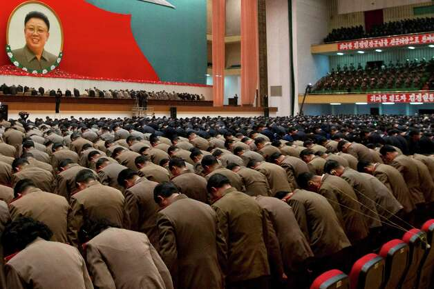 FILE - In this Dec. 16, 2012, file photo, North Korean military officers bow in front of an image of late North Korean leader Kim Jong Il during a national meeting of top party and military officials Pyongyang, North Korea, on the eve of the first anniversary of Kim's death. (AP Photo/Ng Han Guan, File) ORG XMIT: XWM412 Photo: Ng Han Guan / AP