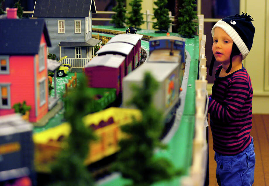 Beau Fronckiewicz, 3, watches trains pass by at the Holiday Express Train Show at the Fairfield Museum and History Center in Fairfield, Conn., on Saturday Dec. 20, 2014. The show, which opened on Dec. 5, will continue until Jan. 4th. The museum will be closed on Christmas and New Year's Day. For more details visit: www.fairfieldhistory.org Photo: Christian Abraham / Connecticut Post
