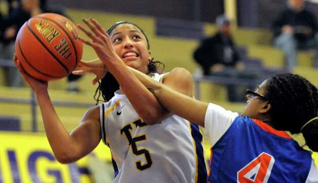 Troy's Shalie Frierson, left, looks to shoot and draws a foul from Nottingham's Love Nicholson during their basketball game on Saturday Dec. 20, 2014, at Troy High in Troy, N.Y. (Cindy Schultz / Times Union) Photo: Cindy Schultz / 00029942A