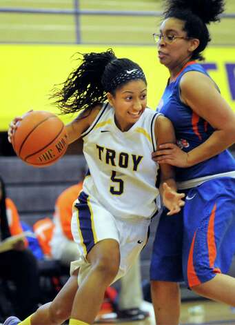 Troy's Shalie Frierson, left, drives past Nottingham's Neziah Mitchell during their basketball game on Saturday Dec. 20, 2014, at Troy High in Troy, N.Y. (Cindy Schultz / Times Union) Photo: Cindy Schultz / 00029942A