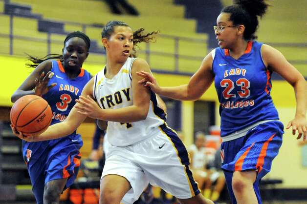 Troy's Kiana Patterson, center, looks to pass as Nottingham's Victoria Afet, left, and Neziah Mitchell defend during their basketball game on Saturday Dec. 20, 2014, at Troy High in Troy, N.Y. (Cindy Schultz / Times Union) Photo: Cindy Schultz / 00029942A