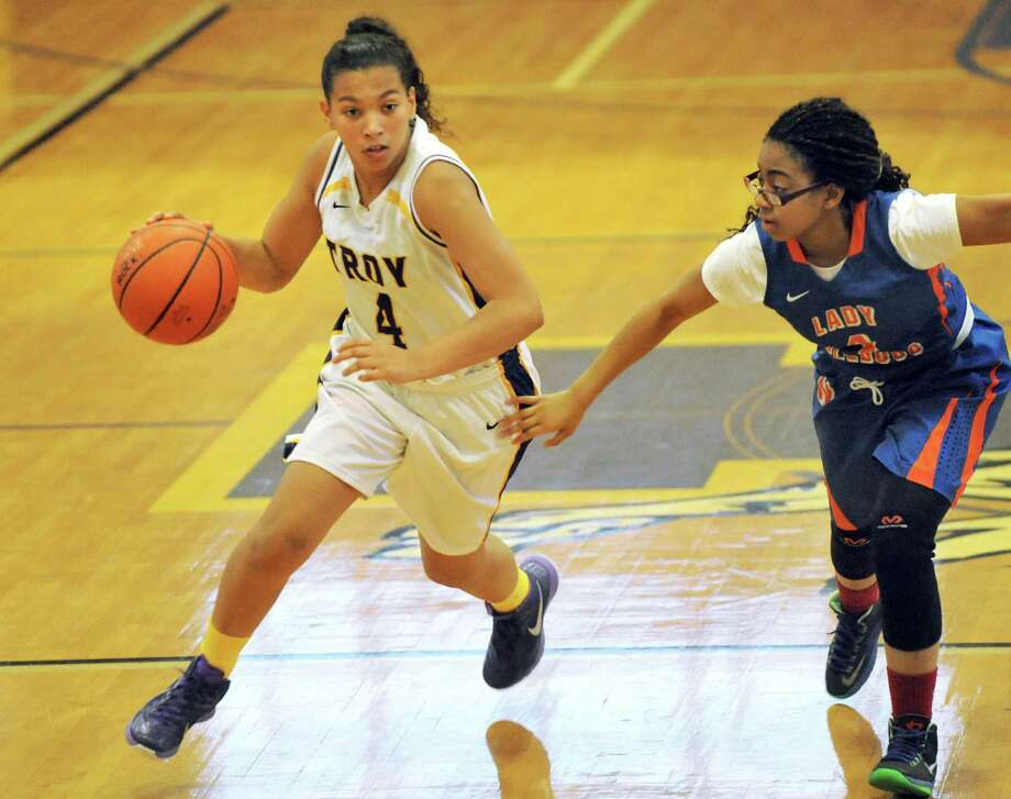 Troy's Kiana Patterson, left, controls the ball as Nottingham's Love Nicholson defends during their basketball game on Saturday Dec. 20, 2014, at Troy High in Troy, N.Y. (Cindy Schultz / Times Union) Photo: Cindy Schultz / 00029942A