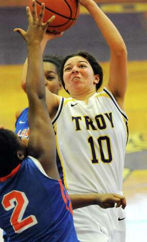 Troy's Sabrina Wolfe, center, goes to the hoop during their basketball game against Nottingham on Saturday Dec. 20, 2014, at Troy High in Troy, N.Y. (Cindy Schultz / Times Union) Photo: Cindy Schultz / 00029942A