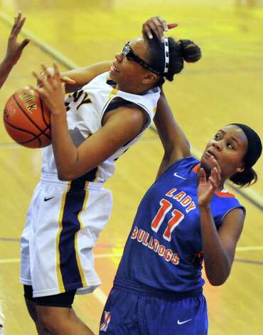 Troy's Alliyah Gillespie, left, draws a foul during their basketball game against Nottingham on Saturday Dec. 20, 2014, at Troy High in Troy, N.Y. (Cindy Schultz / Times Union) Photo: Cindy Schultz / 00029942A