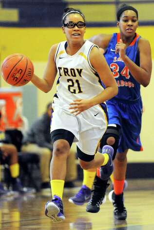 Troy's Alliyah Gillespie, left, drives up court as Nottingham's Kamille Davis defends during their basketball game on Saturday Dec. 20, 2014, at Troy High in Troy, N.Y. (Cindy Schultz / Times Union) Photo: Cindy Schultz / 00029942A